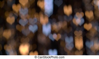 Bright twinkling lights heart shaped against. Bokeh background