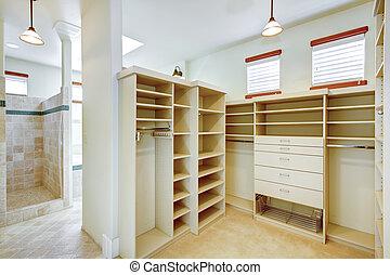 Bright warm bathroom combined with walk-in closet - Walk-in ...