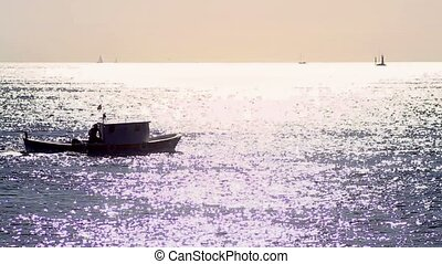 Bright, warm sea with fishing boat