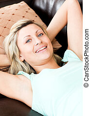 Bright woman using a remote in the