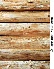 Bright wooden log wall - Wall made of bright wooden logs. ...