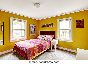 Bright yellow bedroom interior