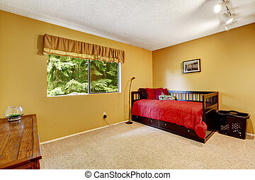 Bright yellow bedroom with black wooden bed