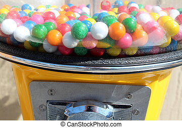 Bright yellow bubble gum machine
