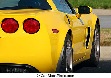Bright Yellow Car - Rear view of a bright yellow sports car