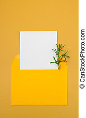 Bright yellow envelope with blank white card