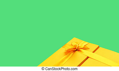 Bright yellow giftbox on bright green background