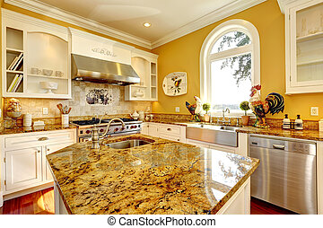 Bright yellow kitchen room with granite tops