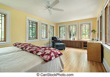 Bright yellow master bedroom