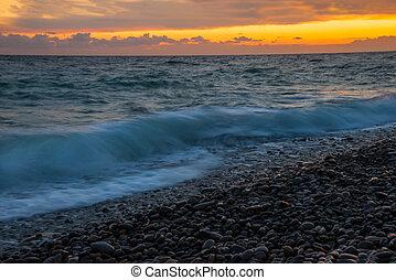 Bright yellow-orange sunset on the sea beach