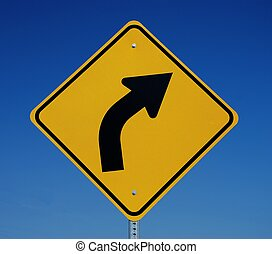 Bright Yellow Right Curve Sign with Blue Sky