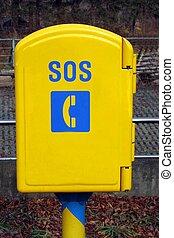 Bright yellow SOS phone box