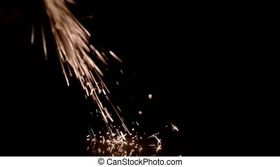 Bright Yellow Sparks on a Black Background - The Metal...