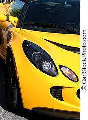 Bright Yellow - Closeup of a bright yellow sports car