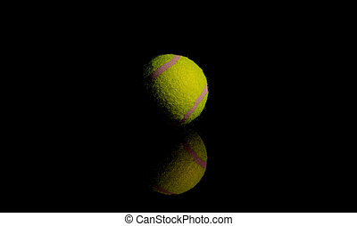 Bright Yellow Tennis Ball on dark mirror with reflections