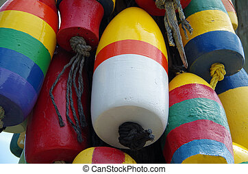 boating buoys bunched - Brightly colored boating buoys ...