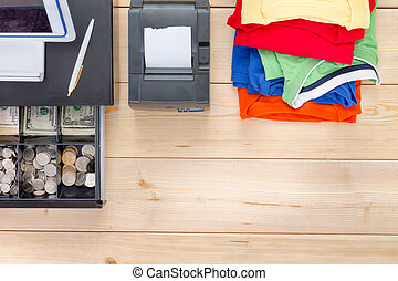 Brightly colored clothes and open cash register