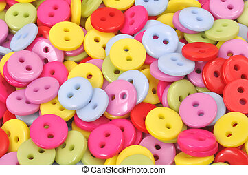 Brightly Colored Clothing Buttons - A scatter of...