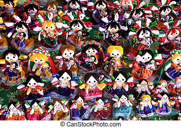 Photo of lots of brightly colored dolls sold at a Mexican Market