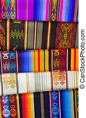 Brightly coloured patterned alpaca blankets