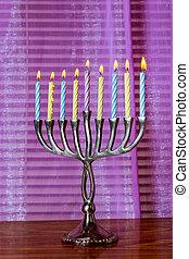 Brightly glowing Hanukkah menorah candles
