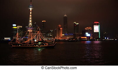 Brightly lit ship passing Shanghai, Pudong - Lit up boat ...
