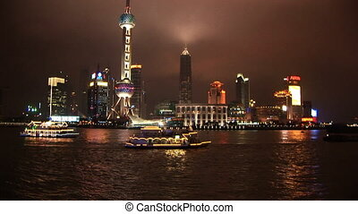 Brightly lit ship passing Shanghai, Pudong