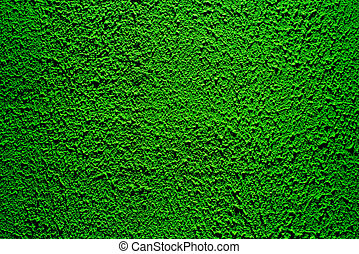 Brightly lit surface covered with bright green plaster.