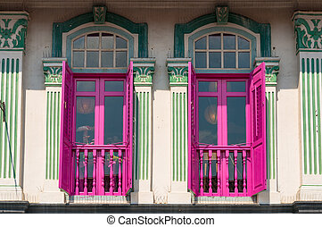 Brightly painted windows on victorian style facade