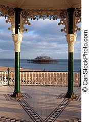 brighton east pier seen through victorian bandstand. sussex coast and beach