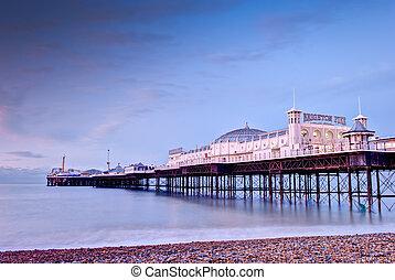 Brighton`s Beach Pier at sunrise , England.