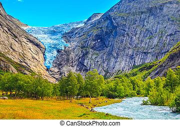 Briksdal glacier, waterfall in Norway