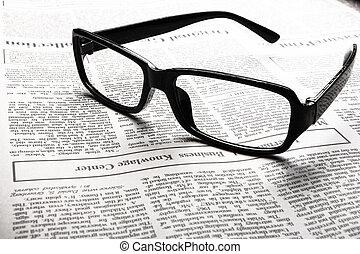 bril op, krant