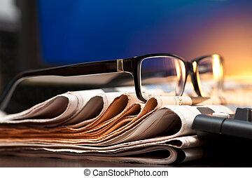 bril op, kranten