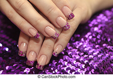 Brilliant French manicure with lilac and golden small glitters