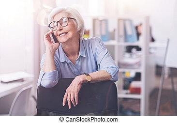Brilliant positive lady enjoying a conversation