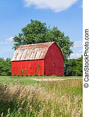 Brilliant Red Barn - A vivid red wooden barn is backed by a...