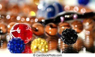Brilliant, shiny, beautiful beads on white background, rotation, close up