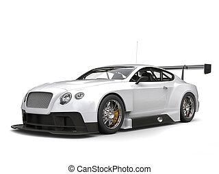 Brilliant white modern super car - studio shot