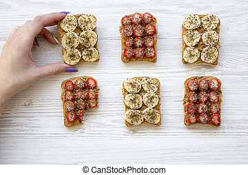 brinde, manteiga, leva, menina, fazer dieta, sementes, amendoim, sobre, branca, jovem, vegan, above., fundo, frutas, madeira, vista., concept., topo