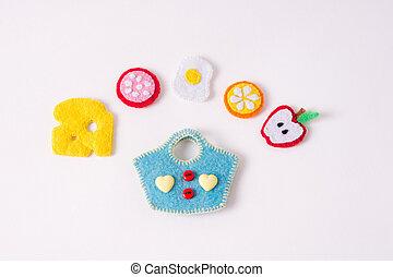 brinquedos, em, a, forma, de, alimento, e, frutas, mão fez, de, feltro, ligado, um, branca, experiência., mão, cosendo