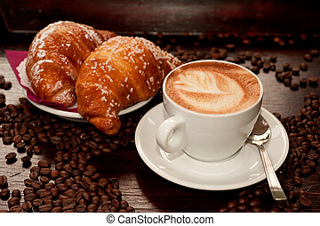 Brioches e cappuccino - Cappuccino and croissant with coffee...