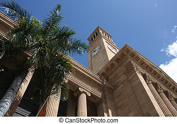 Brisbane city hall and a palm tree. Summer day.