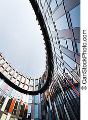 Brise soleil sun breakers on modern office building facade, global warming, sustainable living, future of work concept