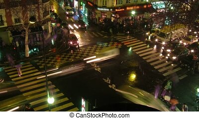 Brisk crossroads in the center of Paris, night life in city...