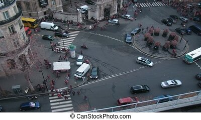 Brisk crossroads in the center of Paris. France. Time lapse. Blurred advertising, license plates, faces, titles