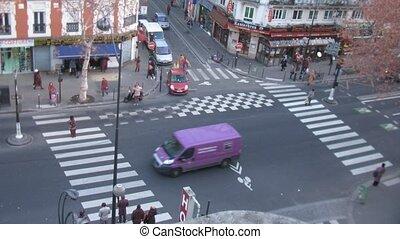 Brisk crossroads near subway station Chateau dEau in Paris, France.