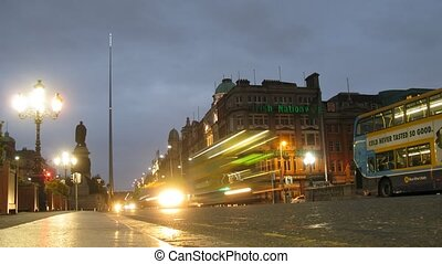 Brisk movement in Connell street at night in Dublin, Ireland.