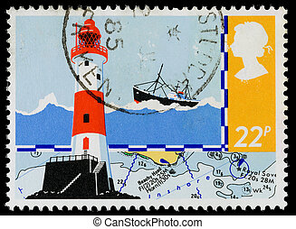 UNITED KINGDOM - CIRCA 1985: A used postage stamp printed in Britain showing Beachy Head Lighthouse and Navigation Chart for Safety at Sea, circa 1985