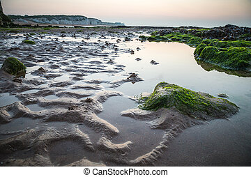 British beach at low tide sunset